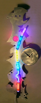 """Whimsy Clock III, featured in this virtual neon art gallery, displaying the neon sculpture and neon art installations, including modern and contemporary art work as well as a line of neon clocks and wall sconces"