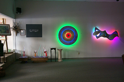 main room featured in this virtual neon art gallery, displaying the neon sculpture and neon art installations, including modern and contemporary art work as well as a line of neon clocks and wall sconces